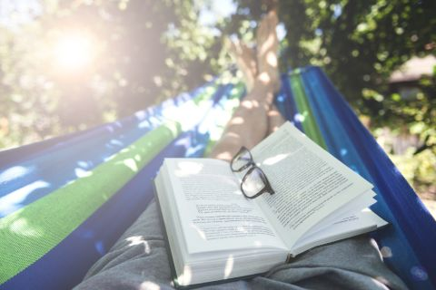 Person reading in a hammock on a sunny day