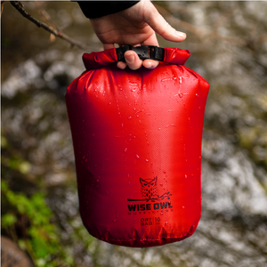 Red Dry Bag covered in water
