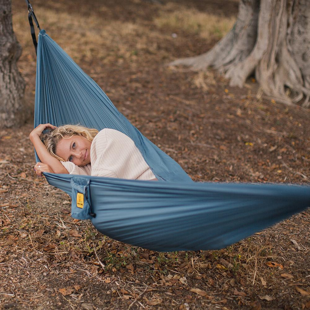 Girl lying in a Featherlight Blue Hammock