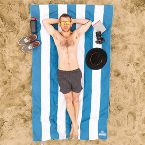 Man laying on a Blue Striped Beach Towel