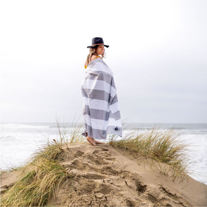 Woman with Grey Striped Beach Towel