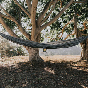 Featherlight Grey hammock outside under a tree