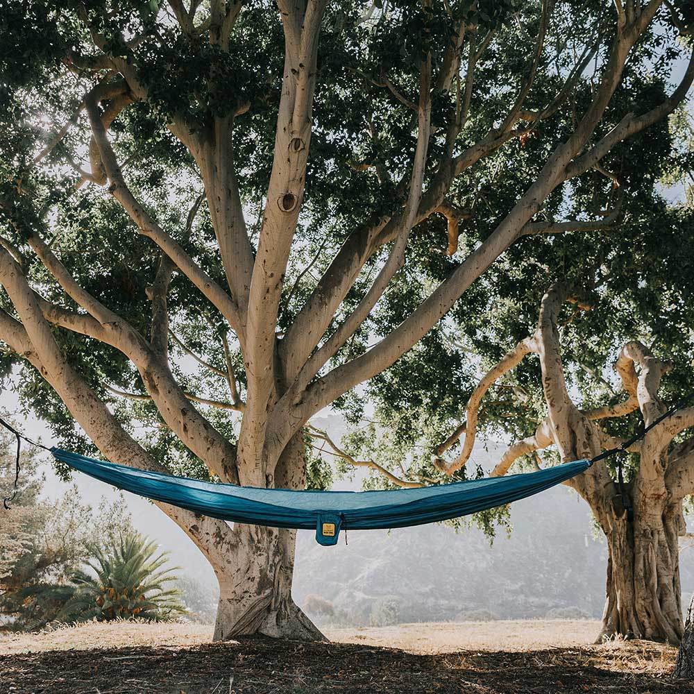 Featherlight Blue Hammock under a tree