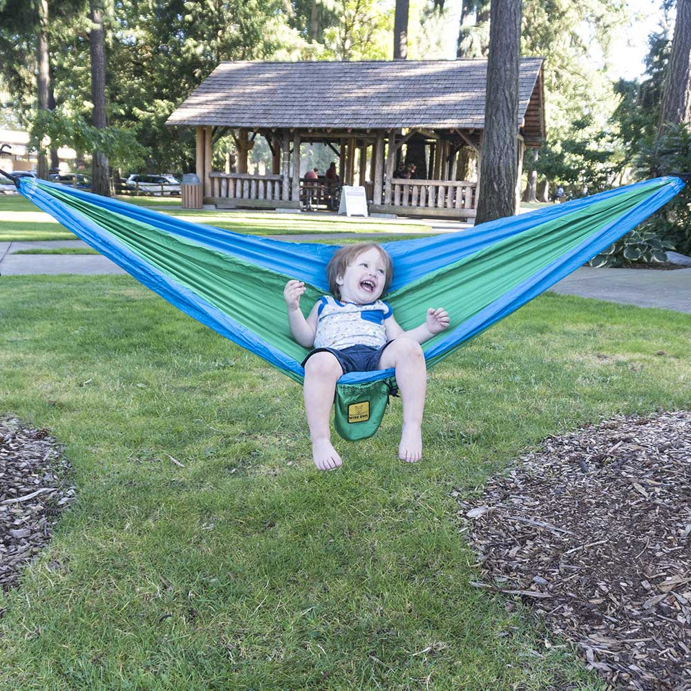 Kid in a Kelly Green & Cobalt Blue hammock