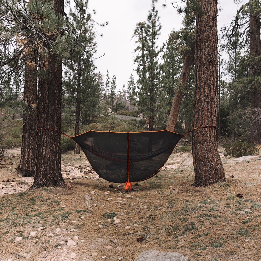 Black & Orange SnugNet Bug Net Set Up Outside