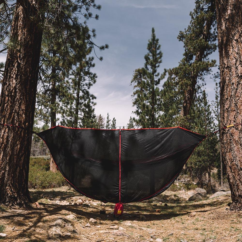 Black & Red SnugNet Bug Net Set Up Outside