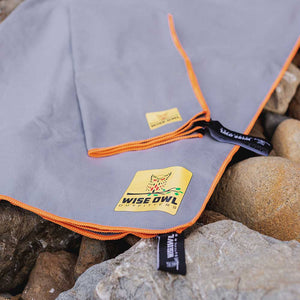 Grey Camping Towel on rocks