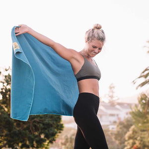 Woman with Marine Blue Camping Towel