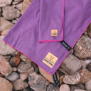 Purple Camping Towel on Rocks