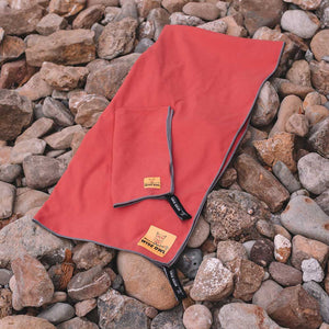 Red Camping Towel on Rocks