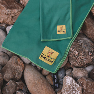 Green Camping Towel on Rocks