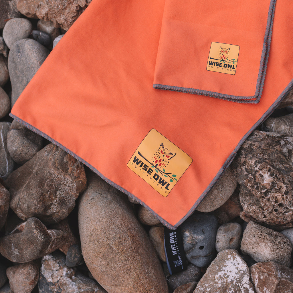 Orange Camping Towel on Rocks