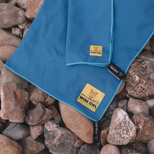 Royal Blue Camping Towel on Rocks