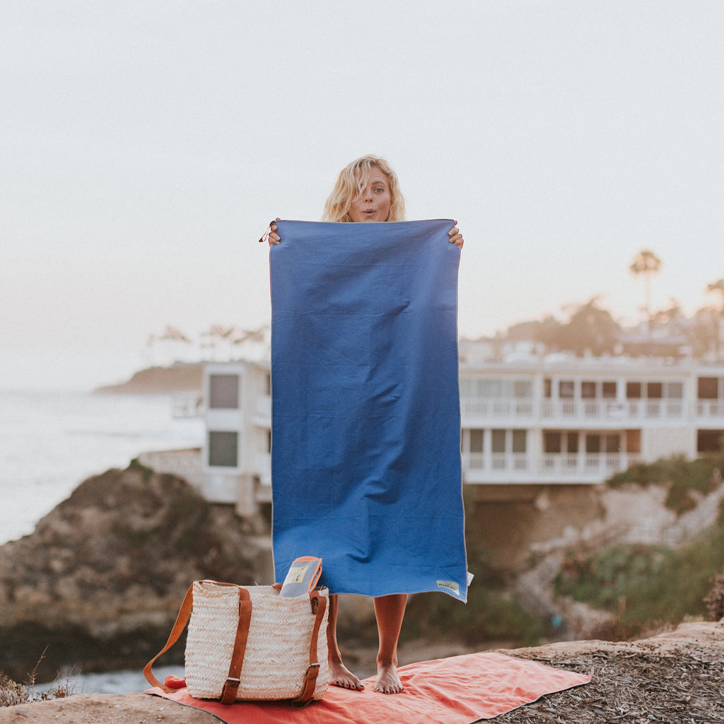 Woman holding Royal Blue Camping Towel