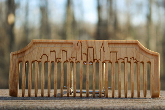 Hand Made Custom Wooden Comb. Has wide comb teeth and long body which is perfect for long beards. It has a simple design of a city skyline.