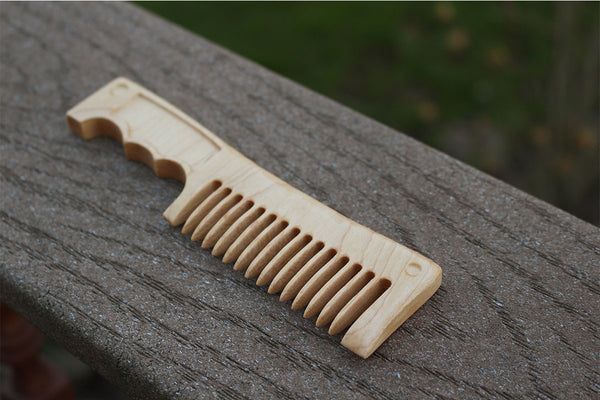 An awesome handmade beard comb that looks like a battle knife