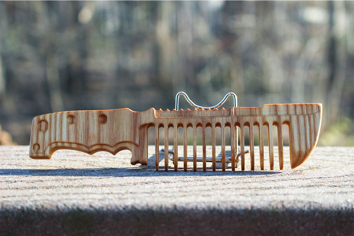 Custom Handmade wooden comb designed like a knife the punisher would use.