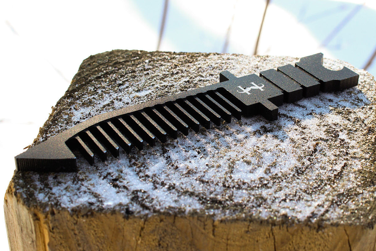 Custom handmade wooden comb with classic army knife design and a bottle opener.