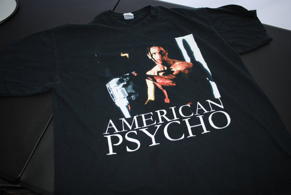 00's American Psycho Vintage Bret Easton Ellis Classic Patrick Bateman Chainsaw in the Stairway Scene 80's Pop Culture 2000 Horror Movie Promo T-Shirt