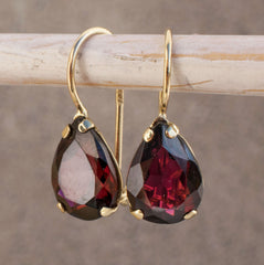 garnet gold dangle earrings