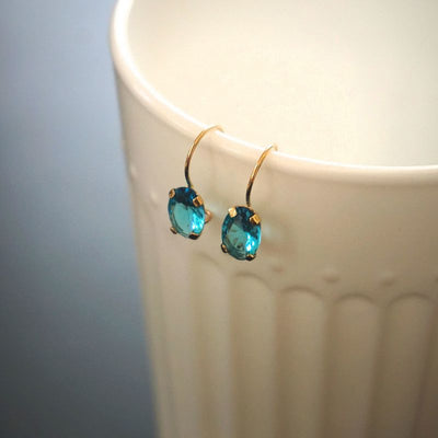 14K Gold Light Blue CZ Oval Dangle Earrings