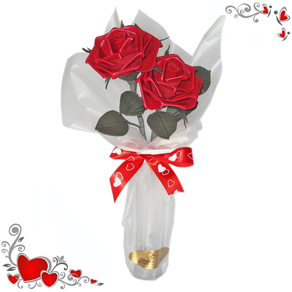 Pair of red leather roses in a vase