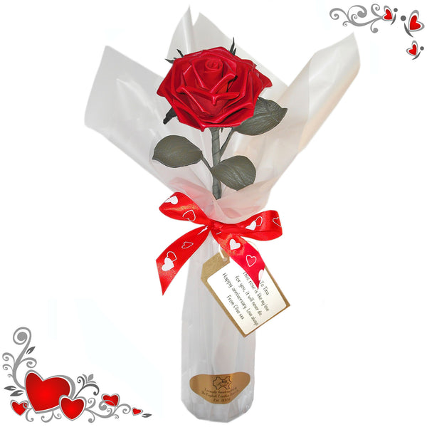Romantic red leather rose in a vase with wrap.