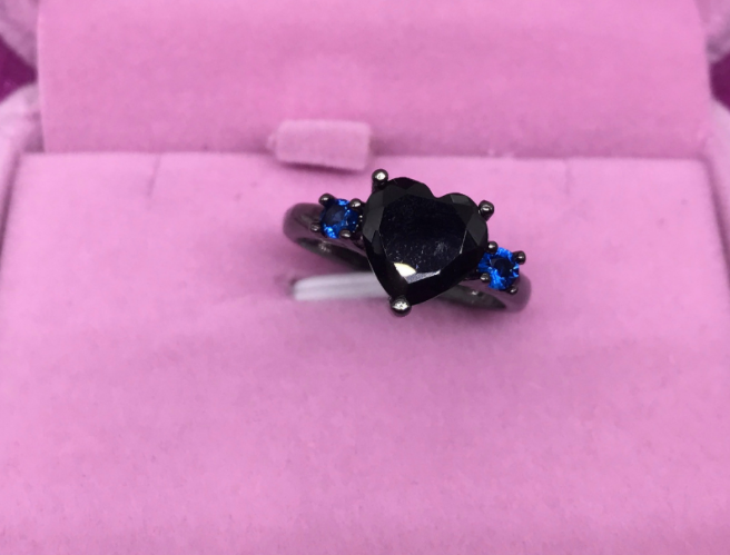 LUXURY WEAR ZIRCON STONE BLACK PLATED RING.