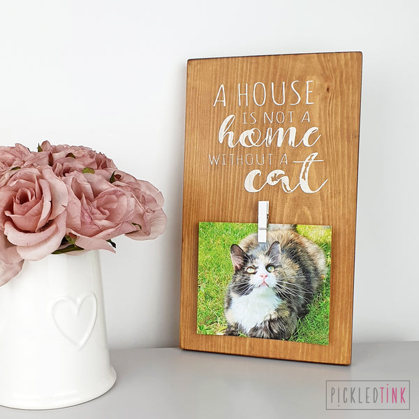 A house is not a home without a cat - Peg Photo Frame