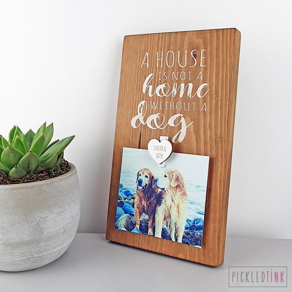 A house is not a home without a dog - Peg Photo Frame