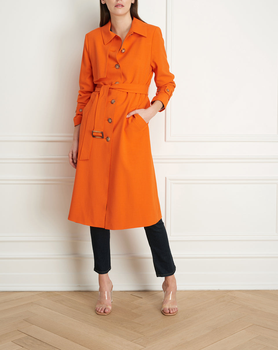 Coat with shoulder flap