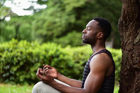 meditating young african american man who is practicing the happier mind hack