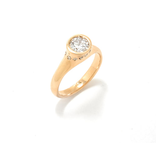 Yellow gold bezel set solitaire