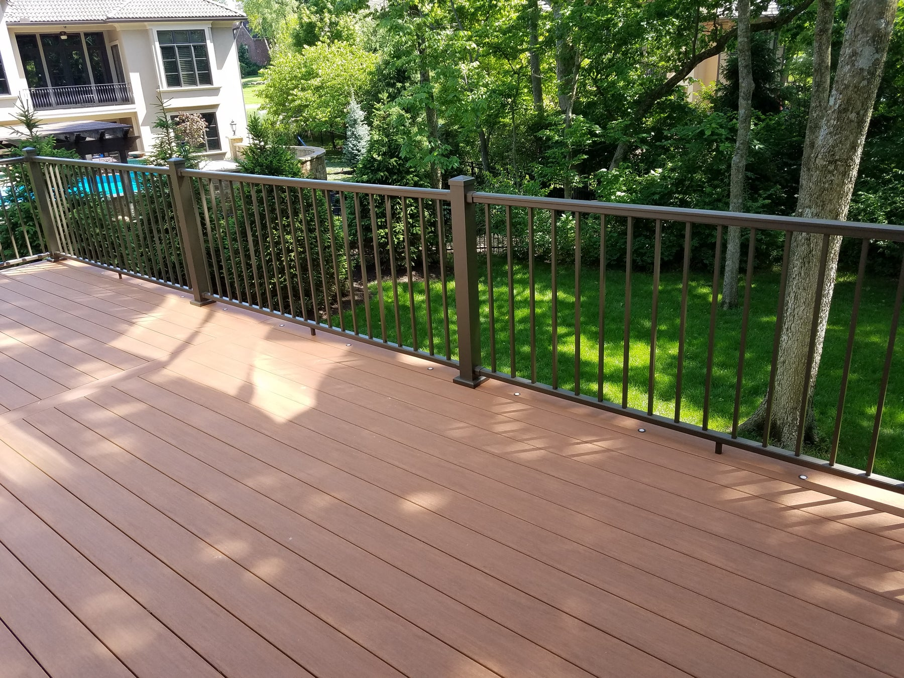 Azek Vintage Decking hidden fastened with cortex screws and plugs and original inpression rail with lighted deck dots. Impression rail is no longer an available railing option.