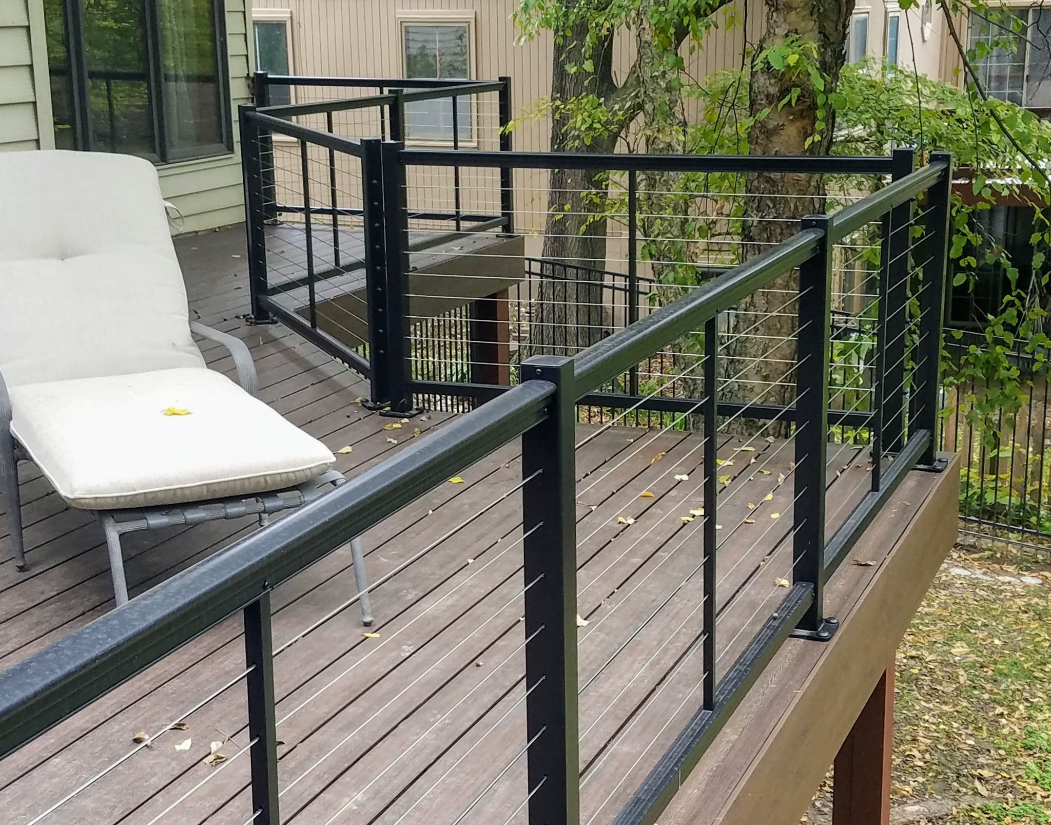 DesignRail Kits by Feeney built by Acumen Renovations in black  horizonatal cable handrail system deck wire from feeney inc