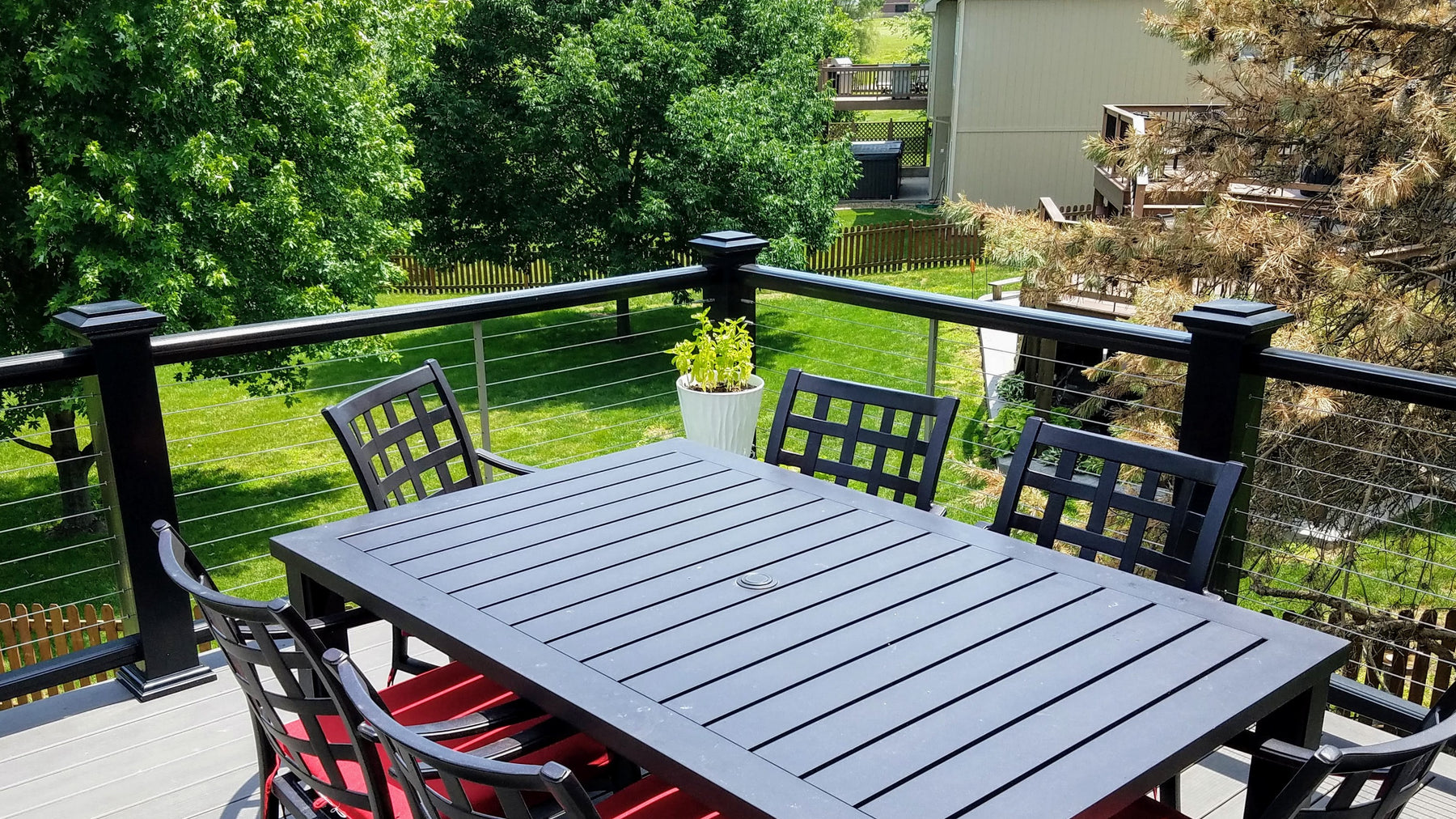 Beautiful back deck in kansas city with wire cable and composite decking
