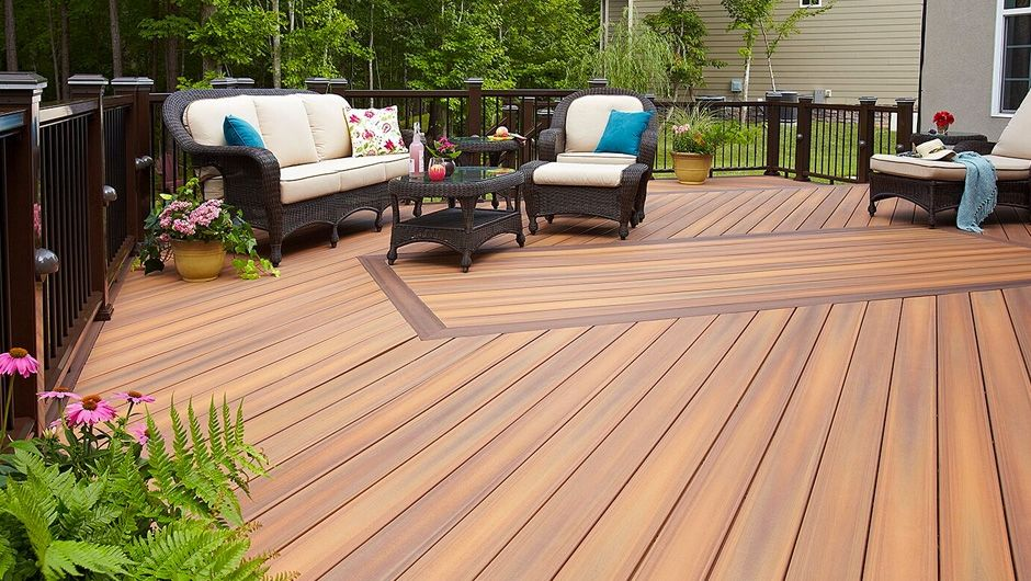 Fiberons original decking - horizon collection made with double sided capped composite decking Tudor Brown and IPE by Fiberon building