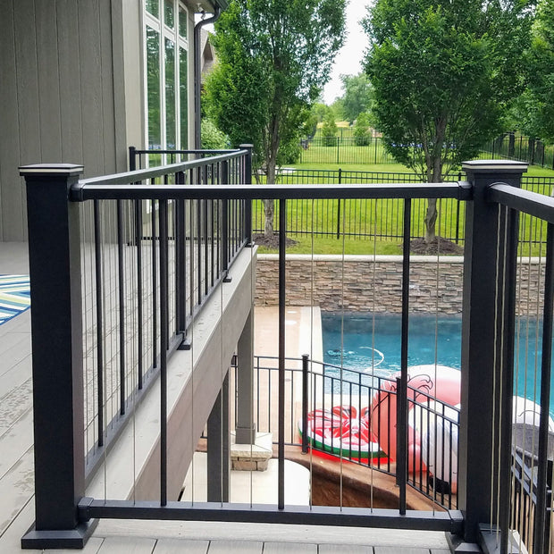 "Top Deck in Black Texture C80 VertiCable a stainless wire railing system by westbury has 4x4 posts w/ lighted caps and 2"" crossover posts"