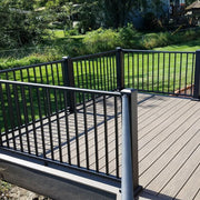 side deck with angled level rail using level angle brackets post with cap and flair all level aluminum black railing