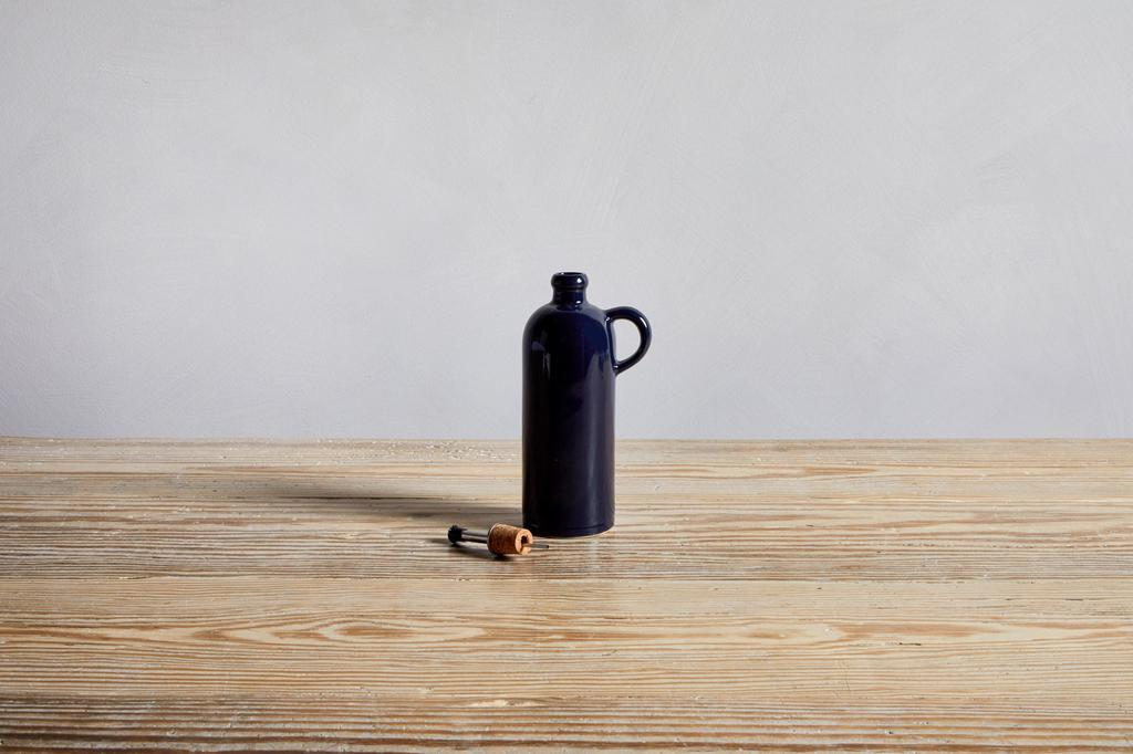 One Small Midnight Blue Manufacture De Digoin Bottle with Handle.