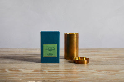 One Bellocq Atelier Candle Le Hammeau Candle and box.