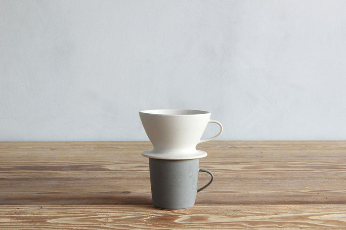 One Sheldon Ceramics Eggshell Coffee Pour Over with coffee cup.