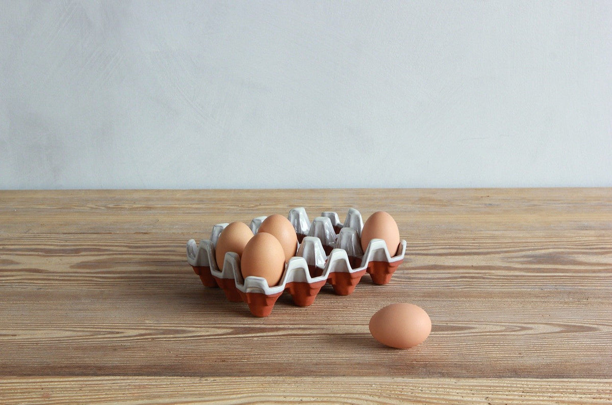 One UK Potter Ceramic Egg Holder and eggs.