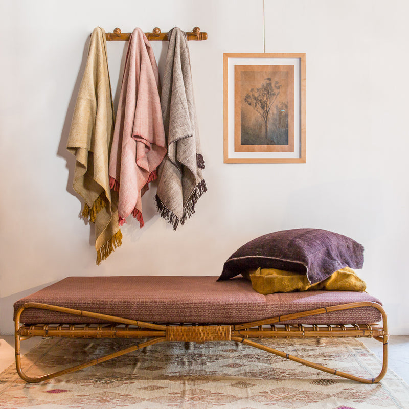 Assorted Neem Tarak Wool Throws in a living room.