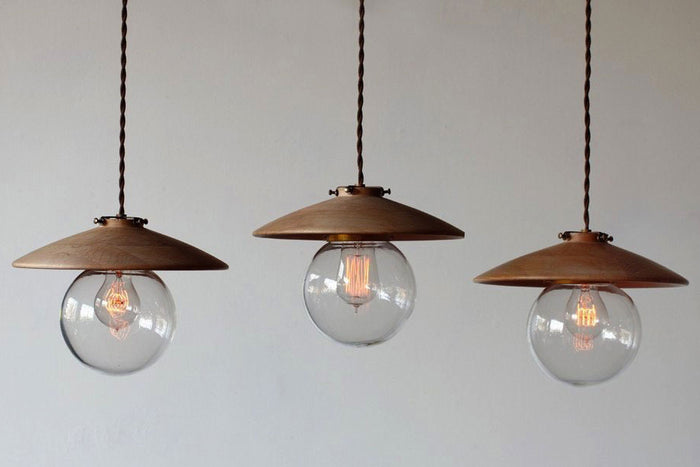 Three Lostine Hand Turned Maple Edmund Pendant Lights.
