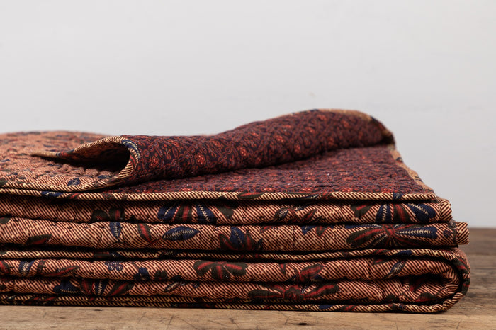 NICKEY KEHOE QUILT, RUST AND NAVY