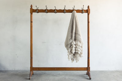 One Tabula Rasa Cream Arcadian Throw on a rack.