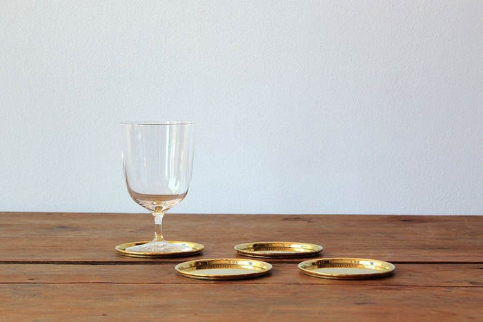NICKEY KEHOE BRASS COASTERS