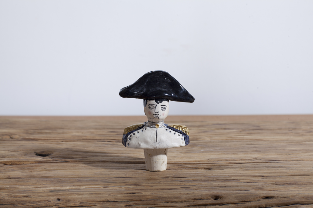 One Napoleon Wine Stopper.