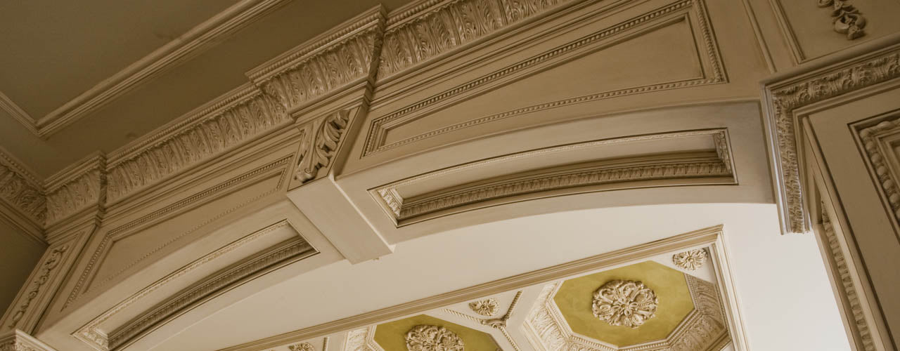 Ornamentally Embossed Crowns and Cove Mouldings